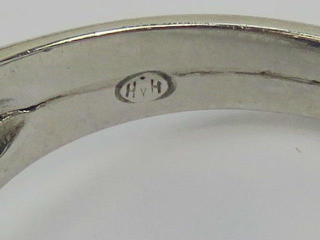 Lot 142 - A heavy platinum, sapphire and diamond r