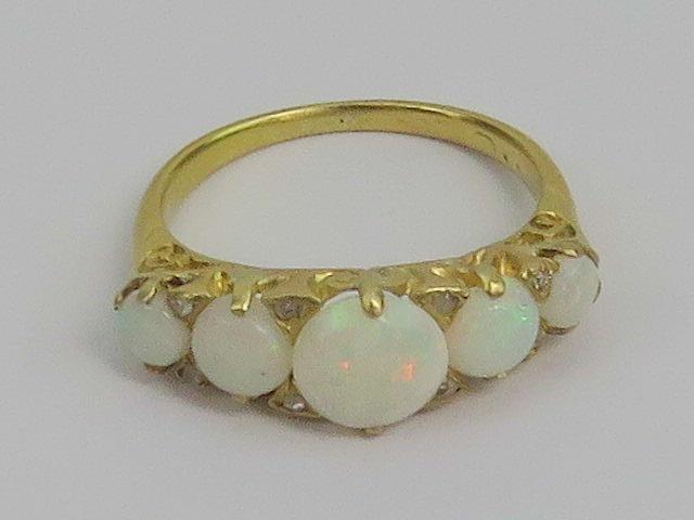 Lot 110 - A late Victorian five stone opal cabacho