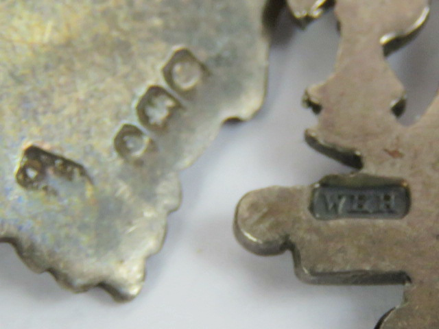 Lot 200 - Two silver fobs, both unengraved, one wi