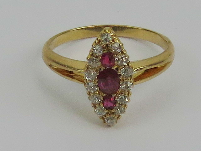 Lot 152 - A ruby and diamond cluster ring having t