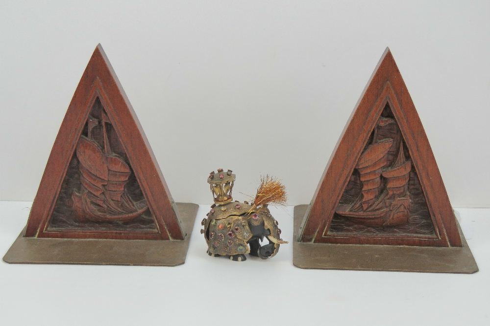 Lot 517 - A pair of Oriental carved wooden and eng