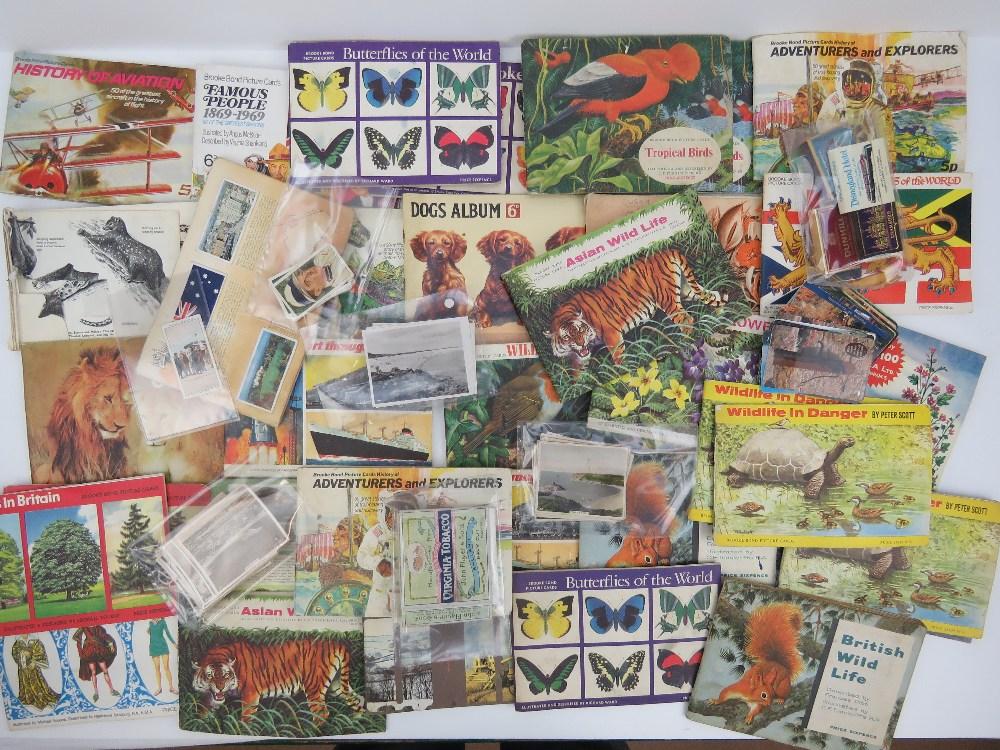 Lot 519 - A quantity of Brooke Bond tea cards, a J
