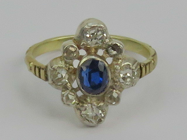 Lot 134 - A 14ct gold diamond and sapphire ring ce