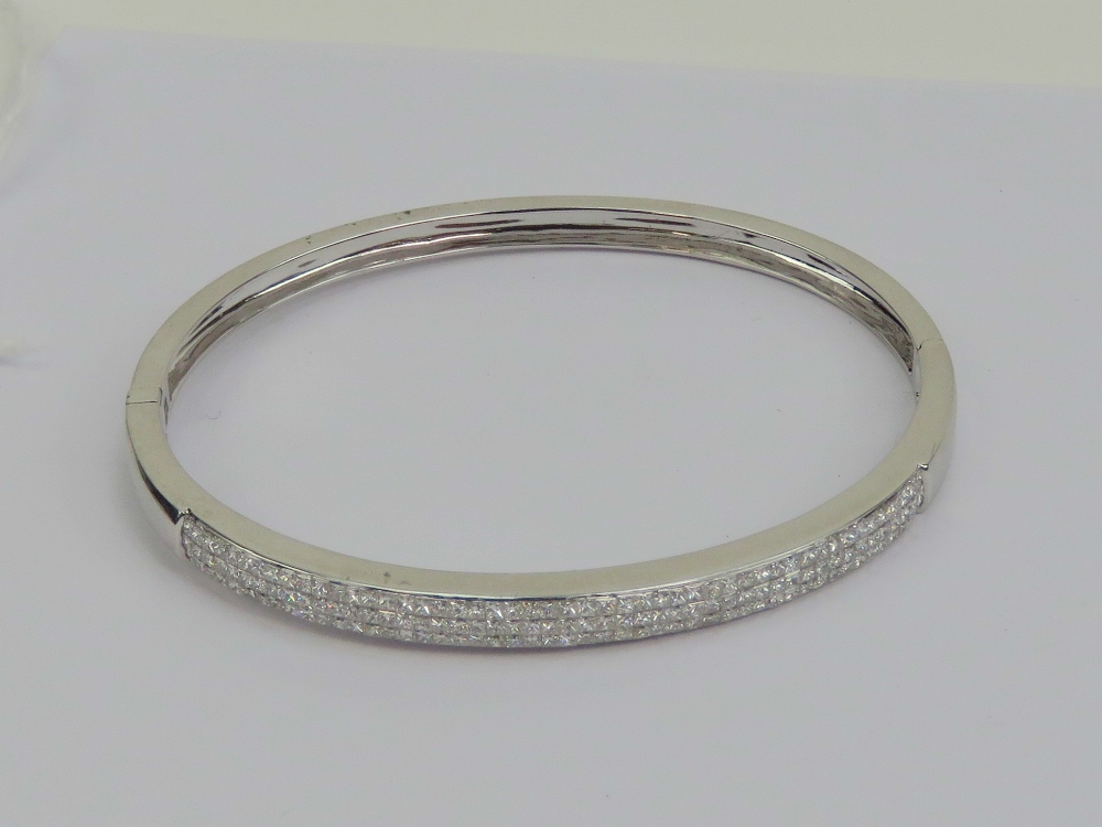 Lot 165 - Am 18ct white gold hinged bangle encrust