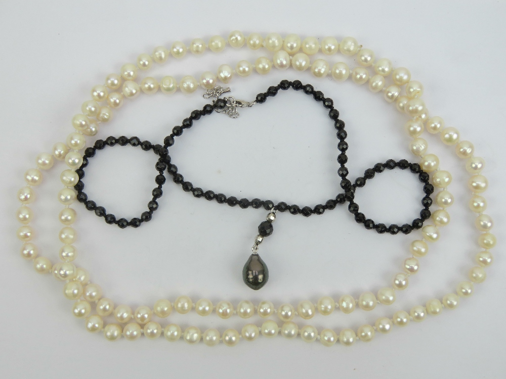 Lot 183 - A strand of individually knotted pearls,