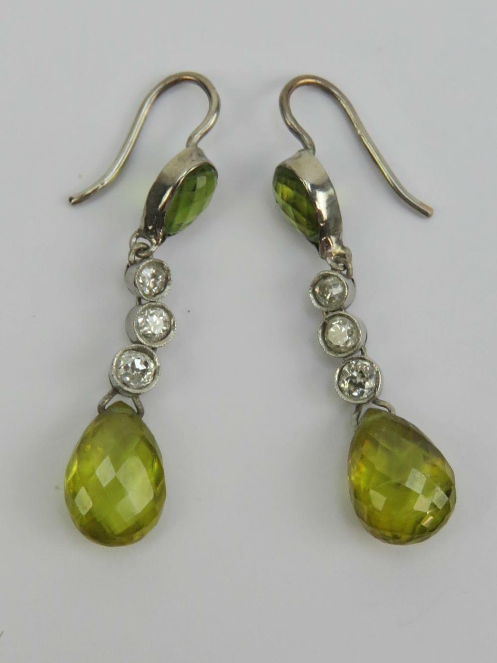 Lot 141 - A pair of diamond and peridot earrings e