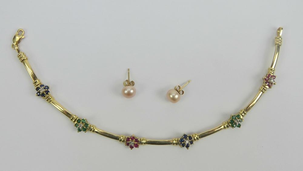 Lot 114 - A 14ct gold bracelet having six floral gem set panels (one stone deficient),