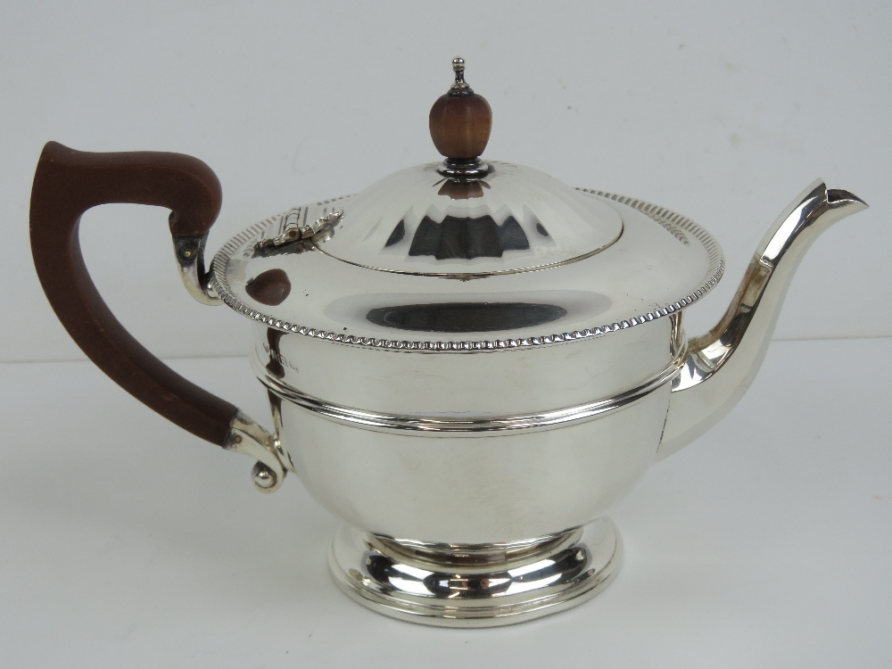 Lot 19 - A HM silver teapot having partially gadrooned body and lid,
