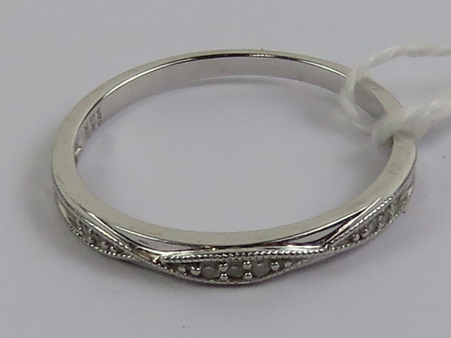 Lot 117 - A 9ct white gold ring having rope twist pattern studded with diamonds to front, stamped 9k,