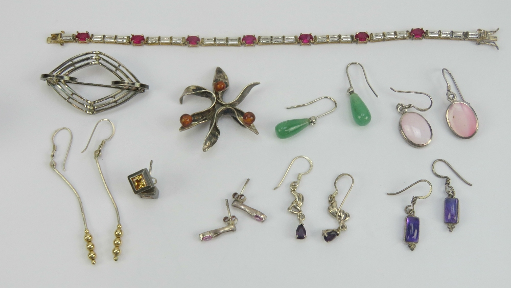 Lot 128 - A quantity of silver and white metal jewellery including red and white stone bracelet stamped 925,