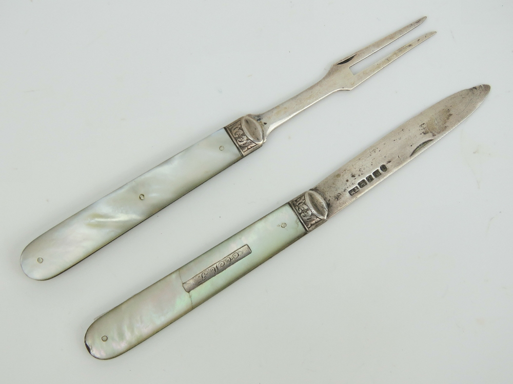 Lot 13 - A Victorian HM silver and mother of pearl folding pocket knife and fork set.