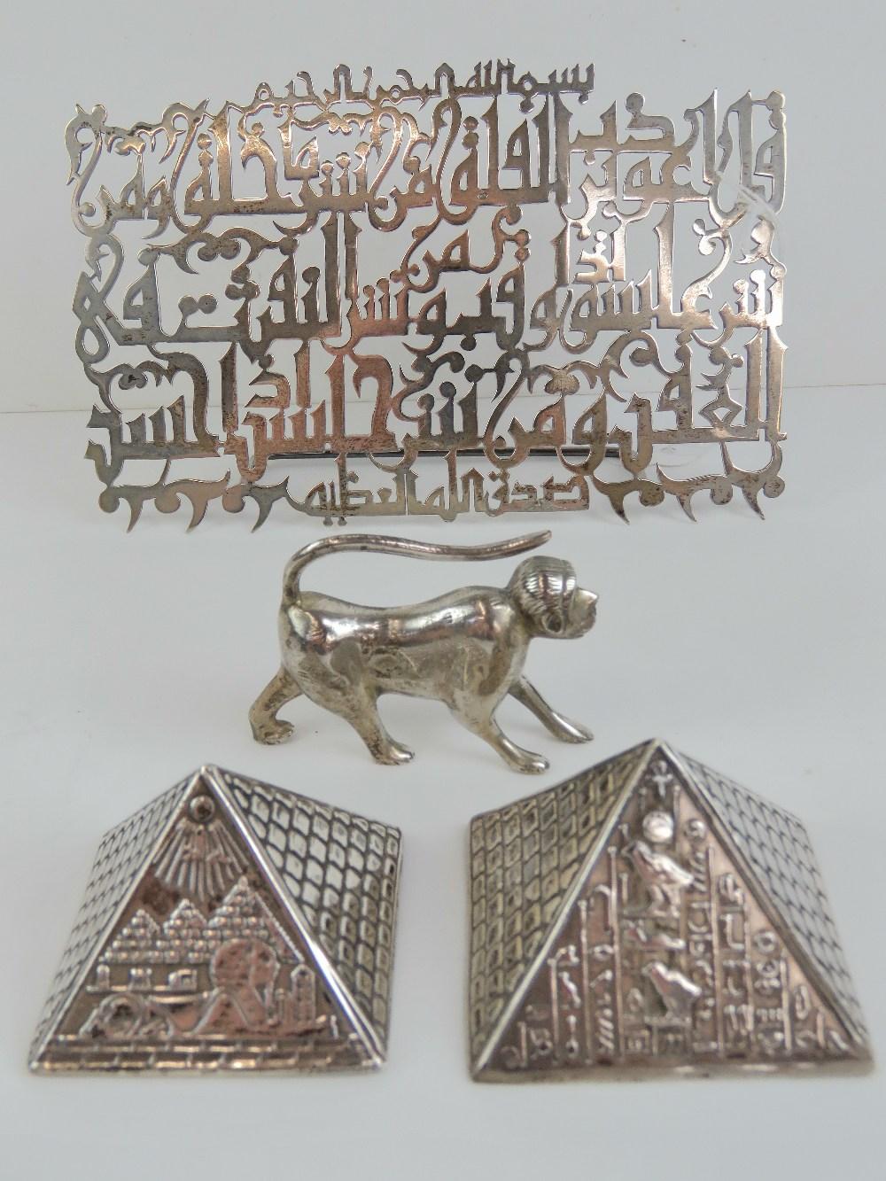 Lot 18 - A decorative pierced white metal excerpt of Arabic text, having Arabic hallmark upon.