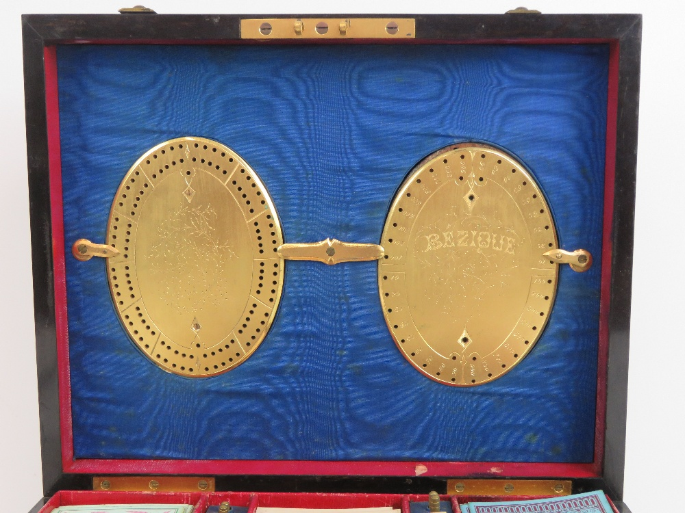 Lot 412 - A superb late 19th Century boxed games compendium.