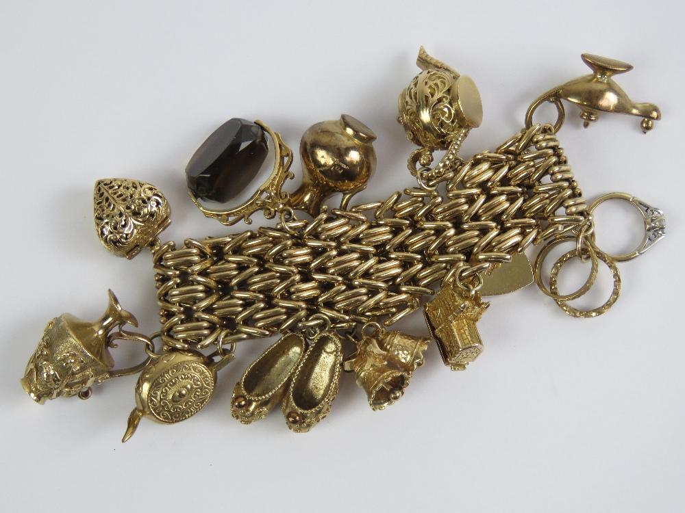 Lot 100 - A 9ct gold charm bracelet having heavy three row bar pattern and heart padlock clasp hallmarked 375,