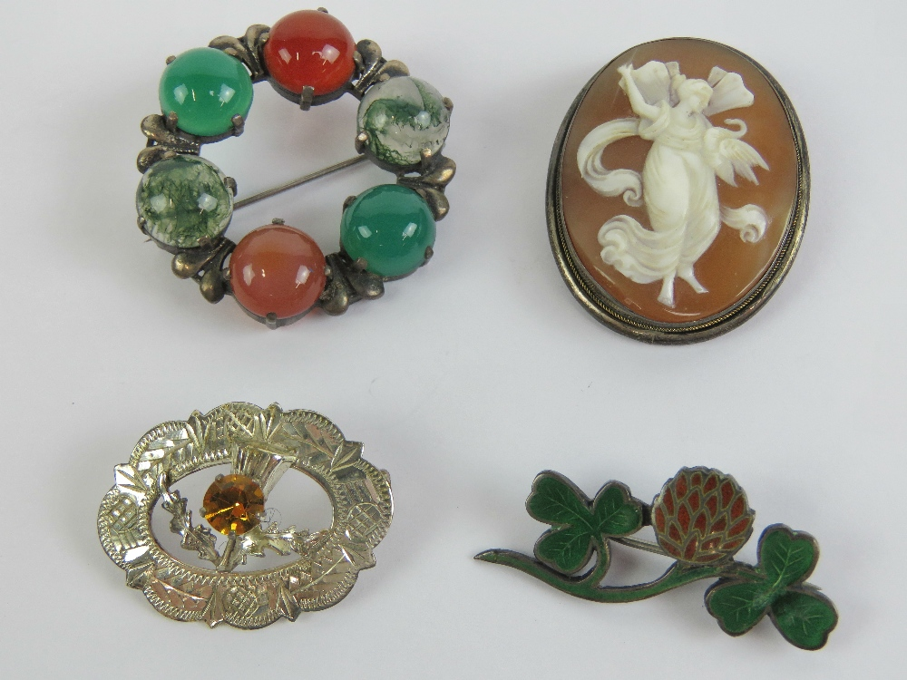 Lot 132 - Four brooches; an enamelled HM silver clover brooch, a HM silver Scottish hardstone brooch,