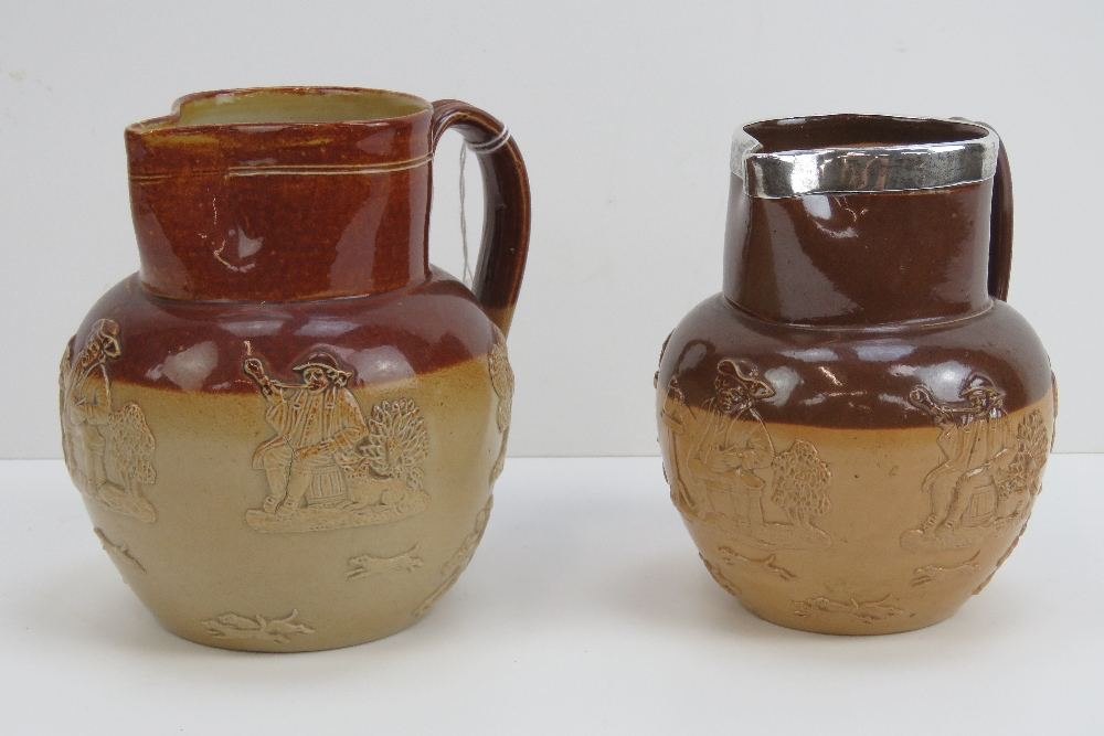 Lot 8 - A Doulton Lambeth stoneware jug with HM silver rim, relief hunting dogs, stag,