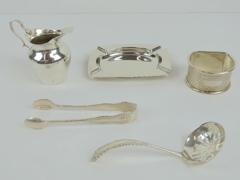 Lot 23 - A HM silver sugar sifter spoon hallmarked Birmingham 1985,