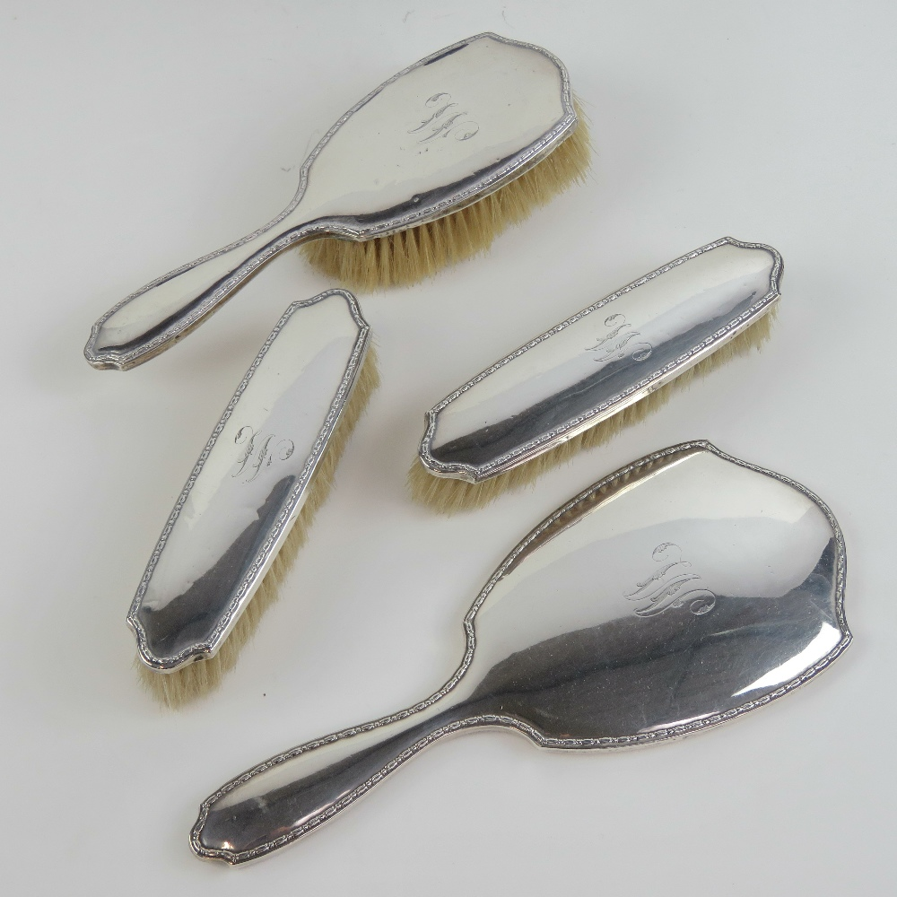 Lot 26 - A superb HM silver four piece ladies dressing table set comprising bevel edged hand mirror with