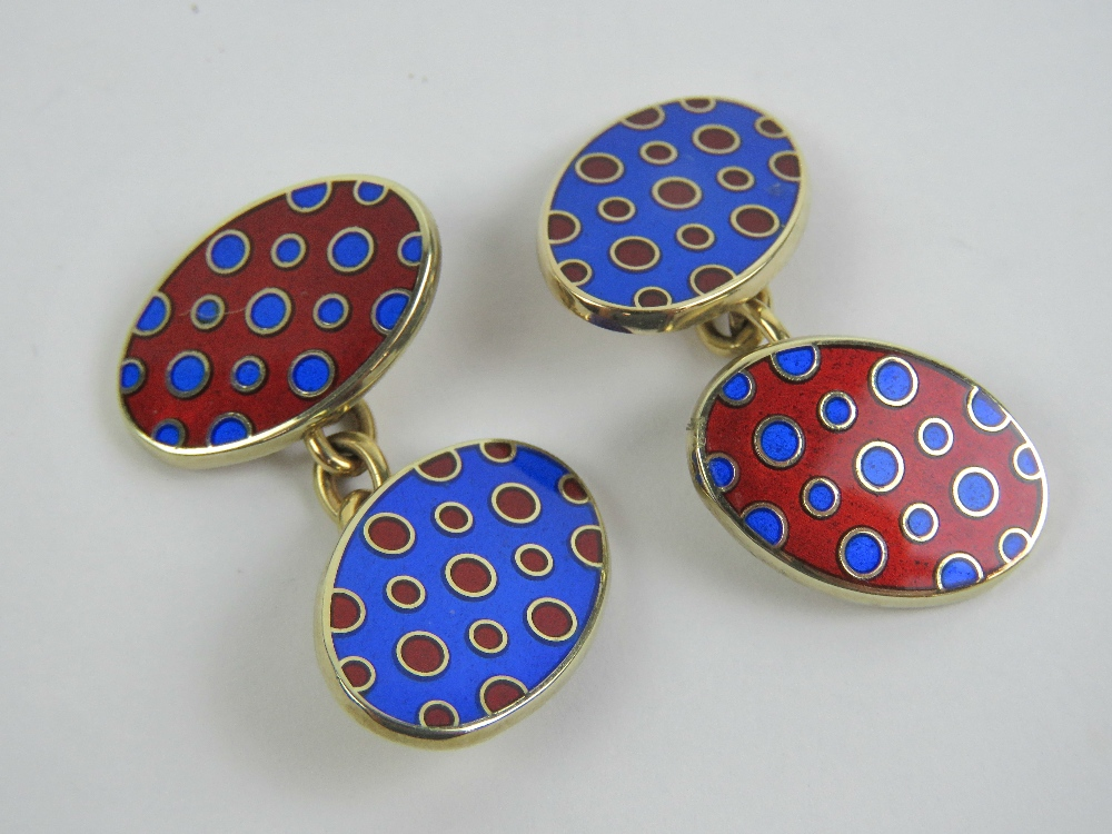 Lot 125 - A pair of 9ct gold cufflinks having red and blue polka dot enamel, hallmarked 375, 14.5g.