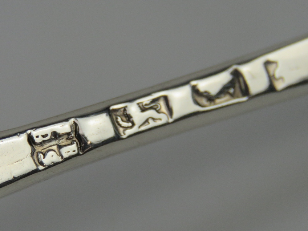 Lot 11 - A HM silver berry spoon measuring 21cm in length having indistinct hallmarked upon (stretched) and