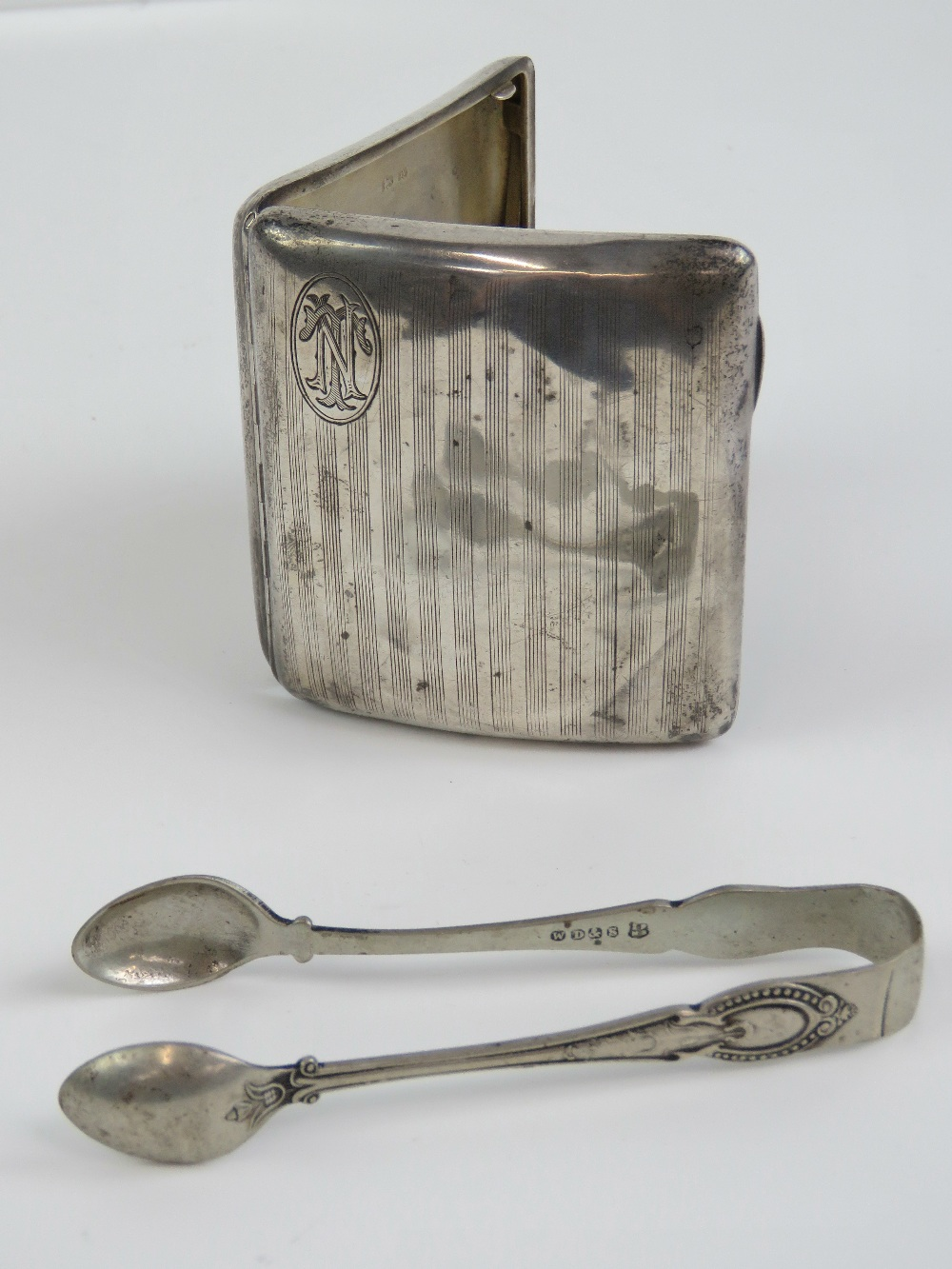 Lot 14 - A HM silver cigarette case with NT monogram to front,