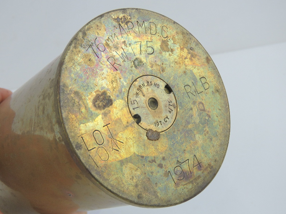 Lot 32 - A brass shell case dated 1974 and stampe