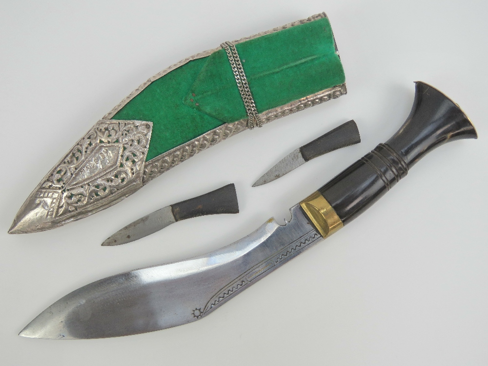 Lot 68 - A fine quality Kukhri knife having curved decorated blade, brass and turned horn handle.
