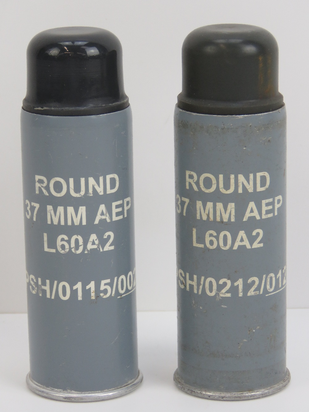 Lot 141 - A pair of L60A2 baton rounds standing 13