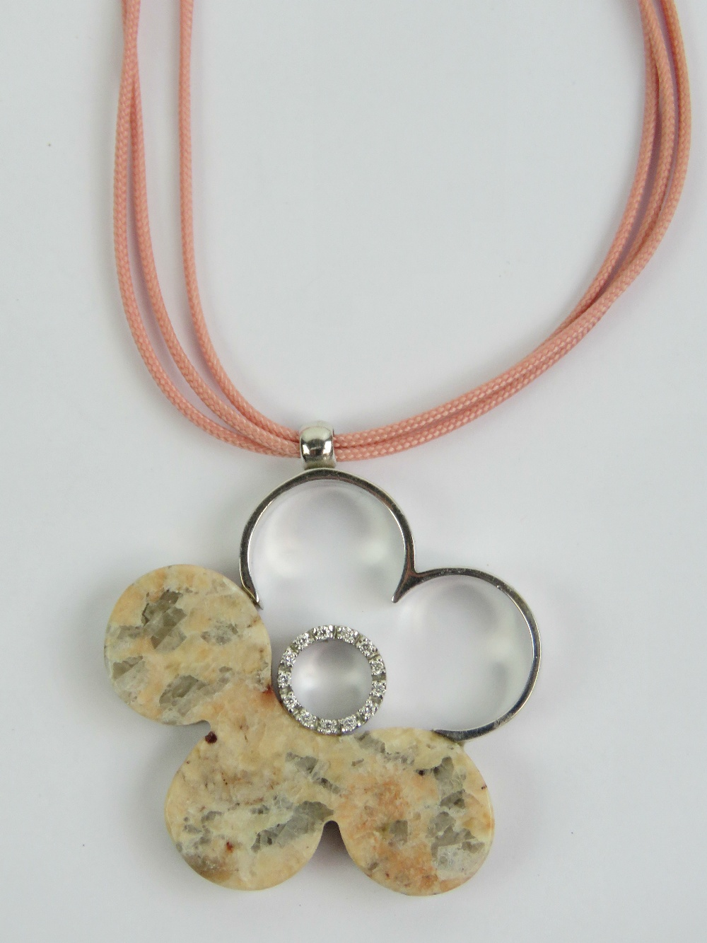 Lot 254 - An 18ct white gold and pink agate floral