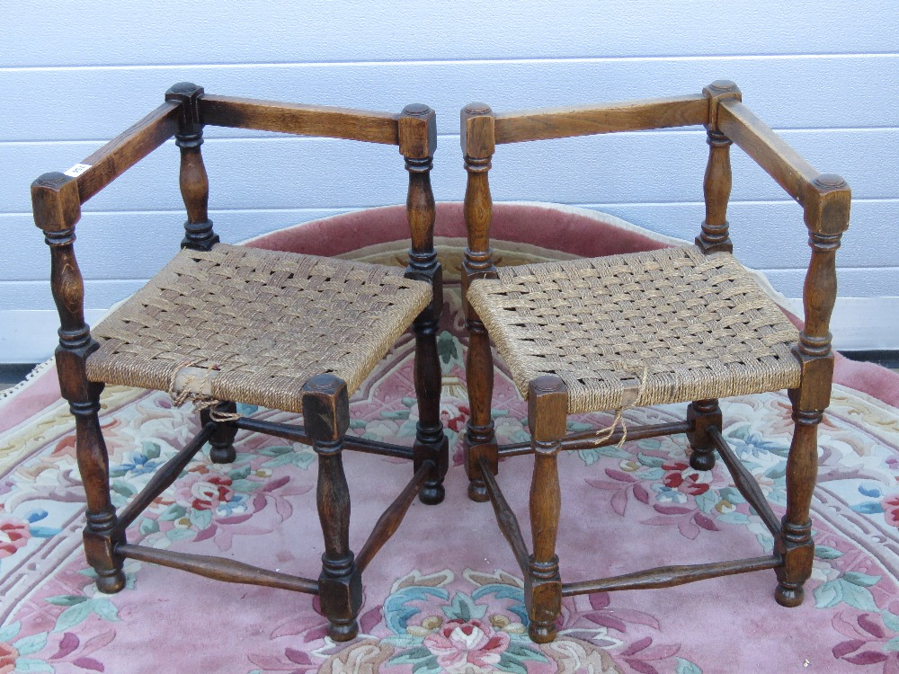 Lot 754 - A matched pair of c1930s oak woven rush