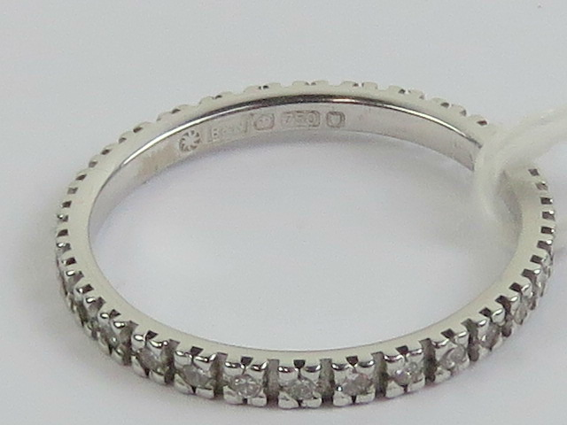 Lot 231 - A 18ct white gold and diamond eternity r