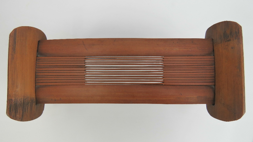 Lot 421 - A Japanese wooden takamakura having fold