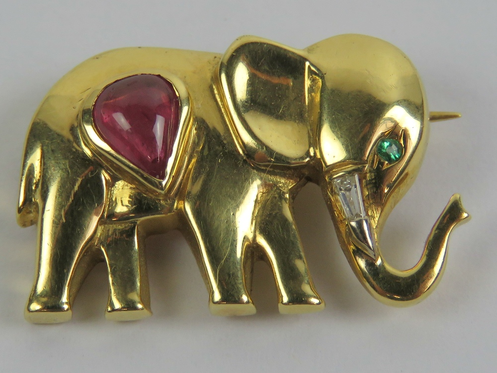 Lot 226 - A yellow metal brooch in the form of an