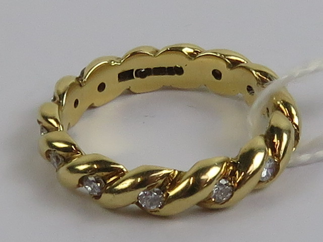 Lot 191 - An 18ct gold and diamond eternity ring h