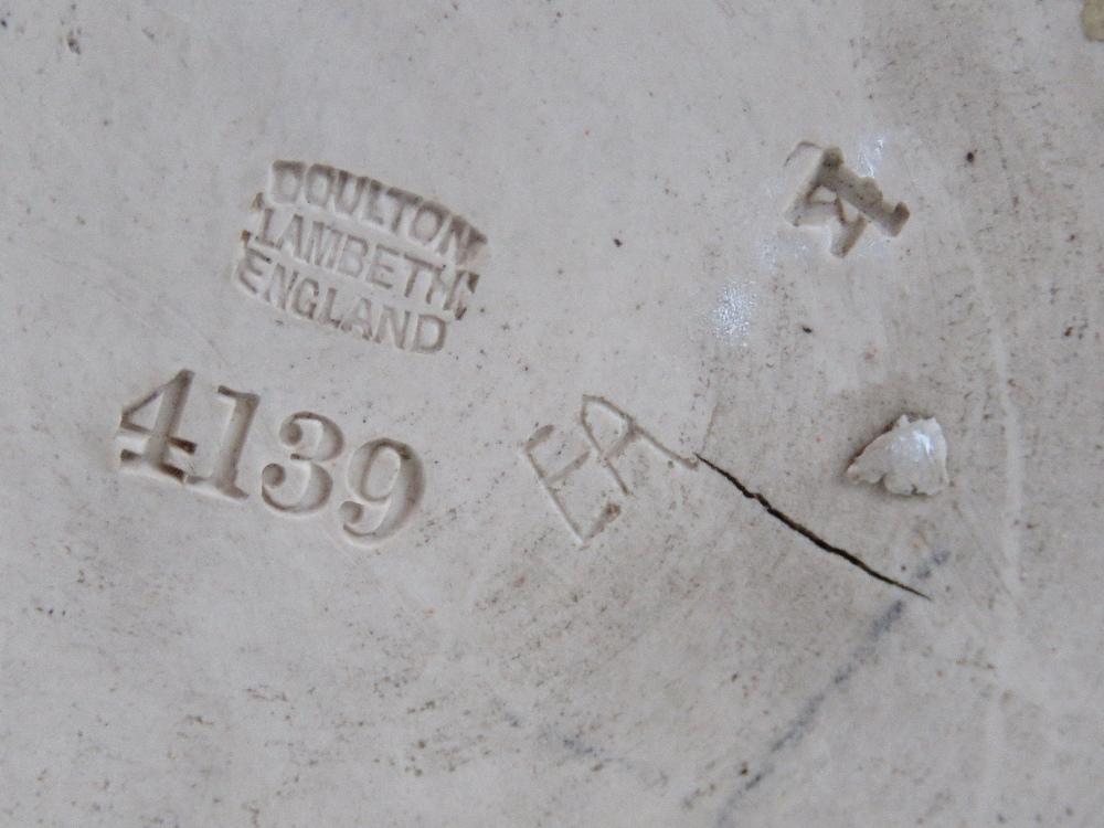 Lot 492 - A Doulton Lambeth 'Scotch' whisky jug, i
