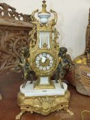 A GILT METAL AND MARBLE LYRE CLOCK SUPPORTED BY BRONZE SATYR CHILDREN, THE MOVEMENT STRIKING ON A