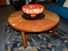 A G-PLAN TEAK COFFEE TABLE WITH INSERT GLASS CENTRE. Dia.97cms.