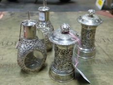 A PAIR OF ORIENTAL WHITE METAL PEPPER MILLS AND TWO ORIENTAL SILVER OVERLAID GLASS OIL BOTTLES. (4)
