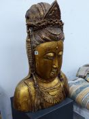 A GOLD LACQUERED WOOD HEAD OF GUANYAN WEARING A JEWELLED DIADEM AND A HALF DAISY HEAD PENDANT. H.