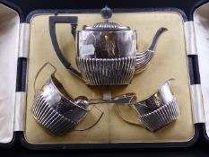 A CAMPBELL & LUMBY CASED SILVER THREE PIECE TEASET, THE HALF GADROONED TEA POT AND CREAM JUG,