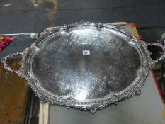 A SILVER TWO HANDLED OVAL TRAY, LONDON 1885 ENGRAVED WITH ALTERNATING FRUIT AND FLOWER VIGNETTES
