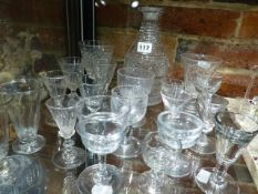 A COLLECTION OF GLASSES AND A DECANTER TO INCLUDE RUMMERS, FLUTES AND ILLUSION GLASSES. (20)