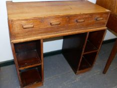 A 20th.C.OAK DESK IN THE MANNER OF HEALS WITH TWO APRON DRAWERS BELOW THE RECTANGULAR TOP AND WITH