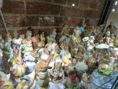 A LARGE QUANTITY OF BESWICK BEATRIX POTTER FIGURES WITH A STAND AND A PAIR OF GERMAN PORCELAIN ETC