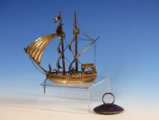 A DUTCH SILVER MINIATURE TWO MASTED SHIP UNDER SAIL WITH ENGLISH IMPORT MARKS. H.14cms TOGETHER WITH