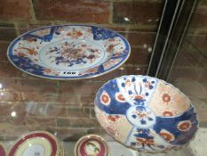 TWO CHINESE EXPORT IMARI PLATES, THE LARGER WITH PRECIOUS OBJECTS AND FLOWERS. Dia.25cms, THE