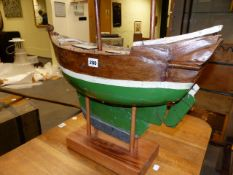 AN EARLY 20th.C.SAILING POND YACHT WITH WEIGHTED KEEL.