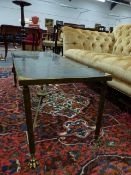 A BRASS LOW TABLE WITH INSET GLASS TOP ON REEDED SUPPORTS. W.100 x H.40cms.