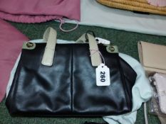 A RADLEY SMALL, SIZE 0, GRAB BAG IN BLACK WITH GREEN ACCENTS AND RADLEY DECORATED METAL STUDDED