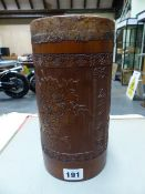 A CHINESE BAMBOO CYLINDRICAL CONTAINER SEALED WITH LEATHER, THE EXTERIOR INSCRIBED BETWEEN CARVED